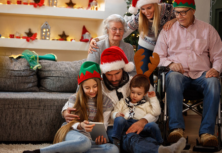 Family with grandma and grandpa enjoy together in Christmas eve