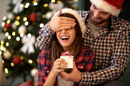 Young girlfriend and boyfriend celebrating Christmas