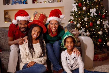 portrait of happy afro American family in Santa hats on Christmas