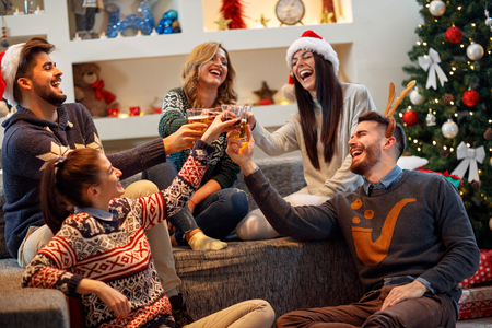 Group of friends having fun on Christmas Party Stock Photo