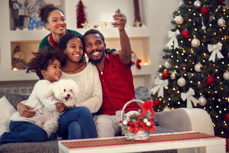 Christmas selfie - Afro American family making together selfie
