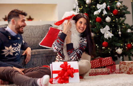 Christmas time- young couple opening presents Banque d'images