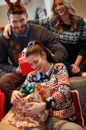 Cute girl open Christmas gift