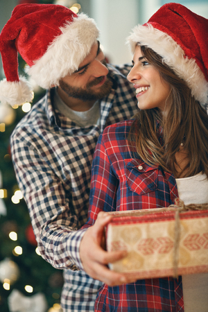 Young pair in love with Christmas gift