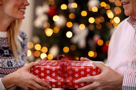 father and daughter exchanging Christmas gifts close up Foto de archivo