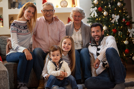 Smiling grandpa and grandma with children enjoy for Christmas Stockfoto