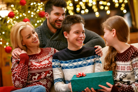Happy family together for Christmas with gift