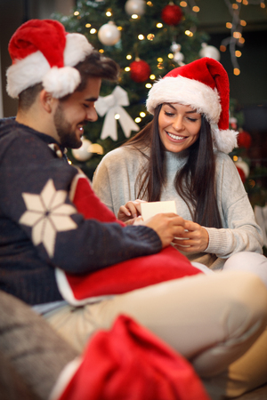 happy couple with presents surprise on Christmas