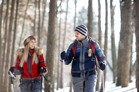 Young couple in love hiking on mountain together