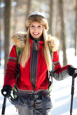 Young female hiker in forest on winter