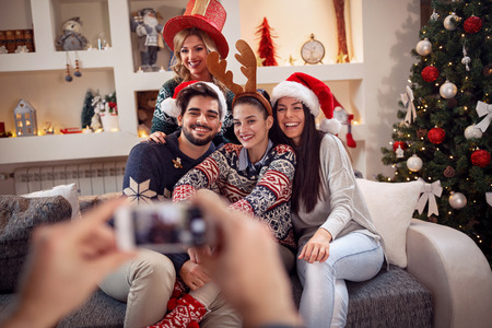 photographing friends by phone for Christmas eve Stock Photo