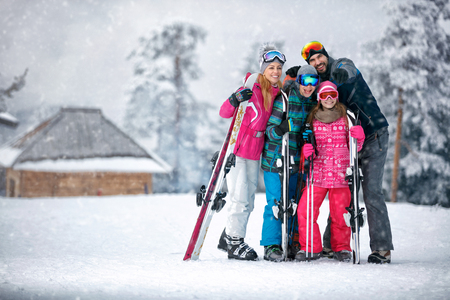 Family, ski, sun and fun on vacation in snow mountains Stock Photo