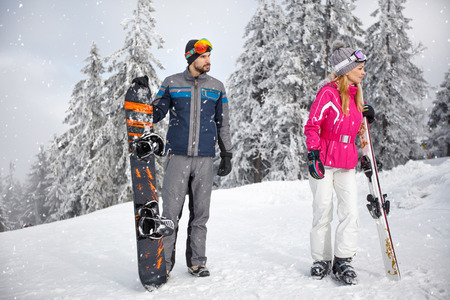 young skiers couple on snowy mountain