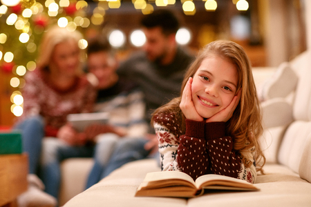 Portrait of cute girl with book
