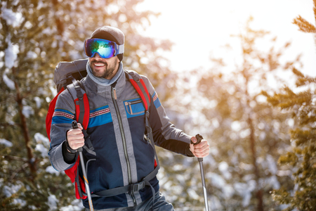 young man goes a sport hike in snow holidays. Nature background Stock Photo