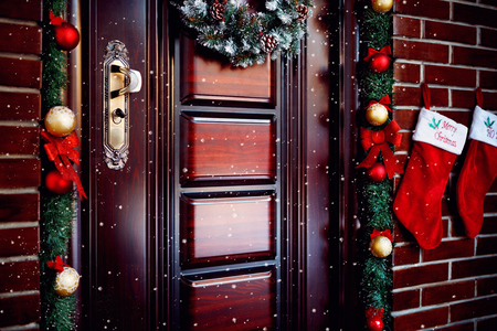 Beautiful decorated Christmas door with wreath and socks Stockfoto