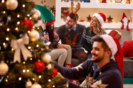 young friends having fun and celebrating Christmas