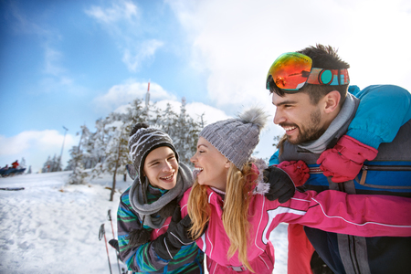 Smiling family together with children having fun on winter vacation