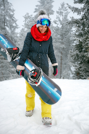 smiling cool young girl snowboarder Stock fotó