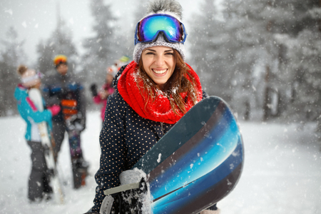 portrait of cool young girl snowboarder