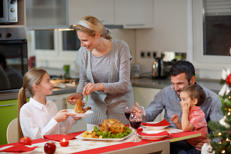 Family enjoying on Christmas dinner together Stock Photo