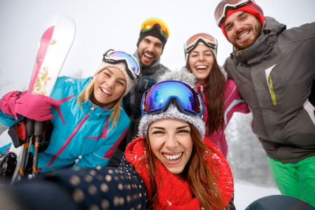 Group of young people taking selfie on mountain