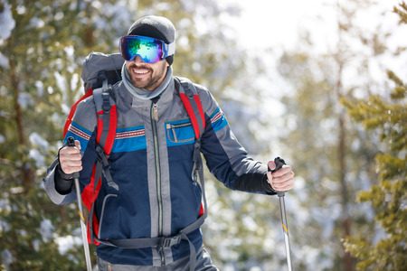 Smiling man with equipment hiking in nature 版權商用圖片