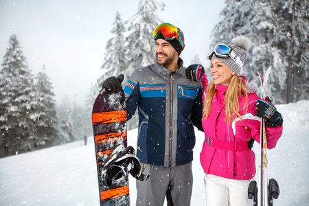 Happy male and female on skiing for winter holiday