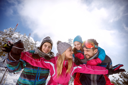 Young woman with family having fun on skiing Stock Photo - 91000270