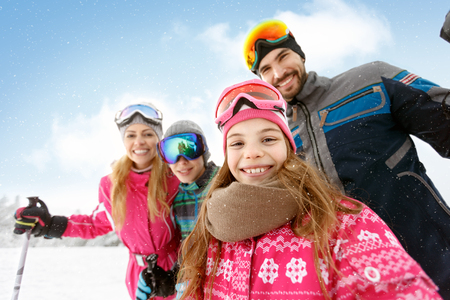 Cheerful family together on skiing Фото со стока - 90819723