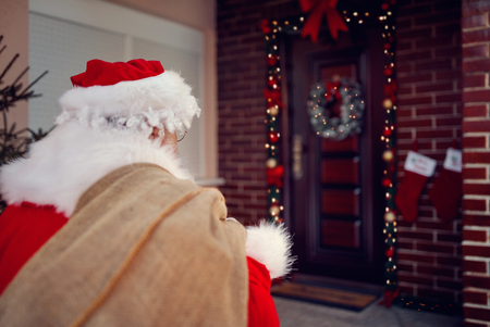 Santa Claus carrying bag with present in Christmas night