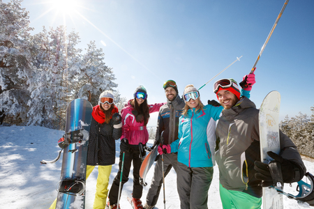 Happy skiers group together on snow