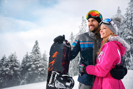 Couple in love  enjoy at skiing in mountain