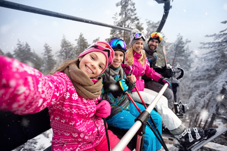 Happy family with children in cable car climb to ski terrain Stock fotó - 93561080