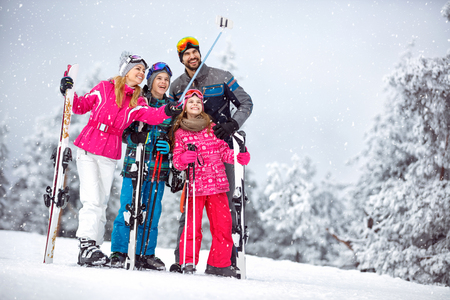 Family skiers making selfie together at snowy mountain