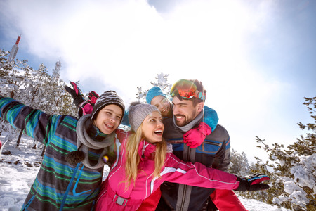 Happy family together on skiing