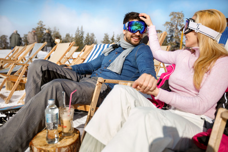 Couple on winter holiday enjoy in mountain