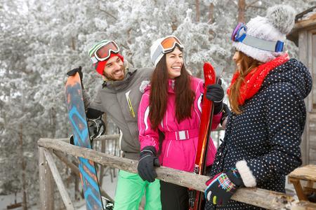 Young skiers in snowy mountain enjoying together Zdjęcie Seryjne
