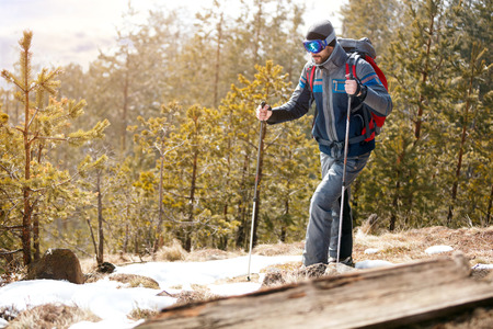 Active young hiker in forest mountains