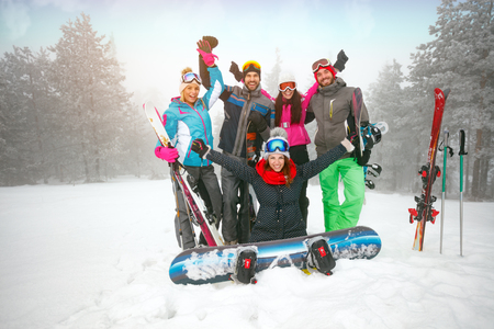 cheerful of group of teenagers friends have a good time in winter
