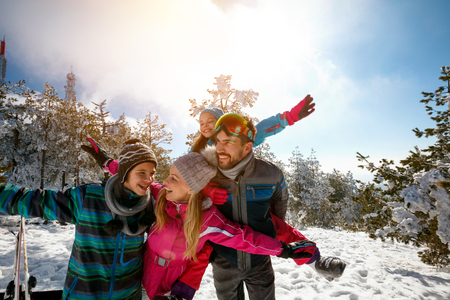 Happy family with children on winter ski vacation Stock Photo