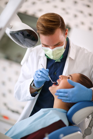 Dentist checking up woman's teeth on dental clinic Stok Fotoğraf - 94440006