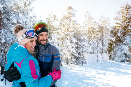 portrait of cheerful couple on winter holidays 写真素材