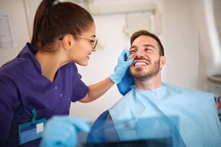 Dentist looking patient's teeth in ordination Stock Photo