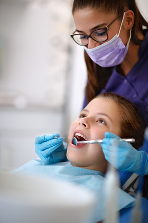 Dentist at work with young female patient in ambulant