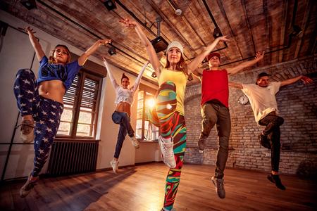 Young modern dancing group practice dancing in jump. Sport, dancing and urban culture concept Foto de archivo