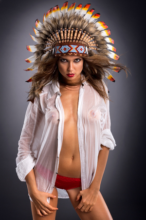 Sexy girl in native American costume with colorful