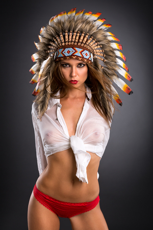 Sexy woman with perfect breast  in costume of American Indian