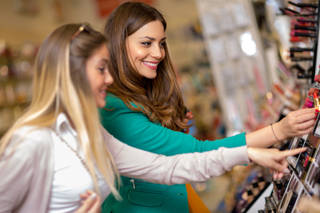 Young women looking cosmetics in the shop Stock Photo
