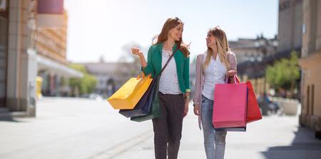 Happy shopaholics shopping at the sales day Stock Photo